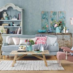 This French country living room in pretty pastels uses creams, blues and pinks to create a stunning colour palette