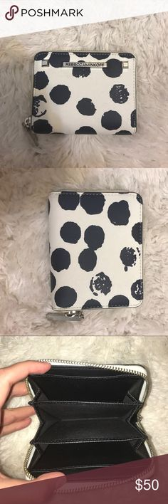 Small Rebecca Minkoff zip around wallet. This small textured leather wallet fits all your cards, but won't weigh you down. The multiple colors makes it easy to find inside your bag. Rebecca Minkoff Bags Wallets