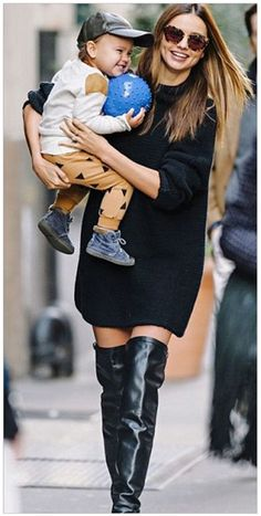 Miranda on the streets of NYC in a sweater dress and over the knee boots