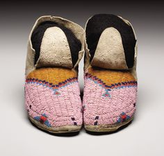 A PAIR OF SIOUX BEADED HIDE MOCCASINS. . c. 1890. ... (Total:   Lot #77080   Heritage Auctions