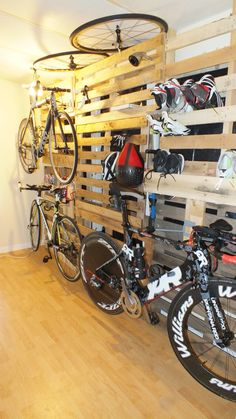 "Some ideas for your training gear warehouse or ""pain cave"", or simply to decorate your tri room! Pallet wall for triathlon training gear!"