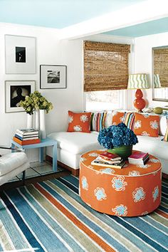 The Easiest Ways To Warm Up Any Room Blue Wallswhite Wallsred Roomsblue And Orange Living