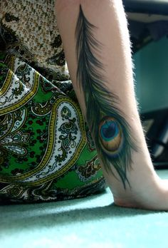 Peacock....I want this with colorful birds flying out of it. Like the typical birds flying from a feather but colored and from a peacock feather. On my arm.