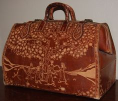 hand tooled leather travel case.......
