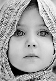 This child has such beautiful eyes! Even though this is a black and white image, you can see a world of wisdom in those eyes!