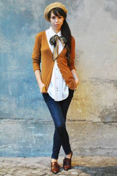 Street Chic: The Italian Way  Who : Daniela Franceschini  What : The new prep look calls for modern oxford shoes and feminine flourishes like a flouncy silk bow-tie.  Wear : Zara sweater and jeans, Urban Outfitters shirt, vintage foulard and shoes