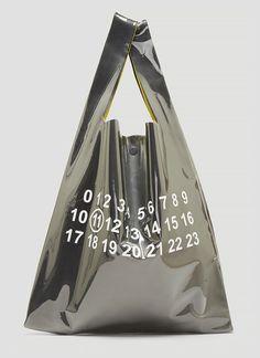 Maison Margiela Logo Plastic Bag Tote Bag In Silver In Grey Plastic Bag Design, Plastic Bag Packaging, Ästhetisches Design, Latest Bags, Cosmetic Items, John Galliano, Tote Handbags, Tote Bags, Shopping Bag