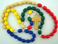 """Youth Kids Multi Color Rainbow Mission Wood Bead 17"""" Corded Daily Prayer Rosary Necklace . $6.49. Makes a great gift!!. Multi Color Wood Beads. WARNING: CHOKING HAZARD - not intended for children under 3 years. Cord 17"""" Rosary w 1.5"""" Crucifix"""