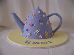 teapot cake - Caramel mud cake Teapot made in the dolly varden pan. Covered in fondx fondant. Enjoy.