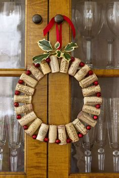 60 Christmas Crafts to Bring a Handmade Holiday to Every Room in the House : Wine Cork Wreath Strung together between red jingle bells, wine corks can dress up the dining room. Bonus: You get to drink all that wine first. Click through for more! Christmas Wreaths To Make, Christmas Door Decorations, Christmas Projects, Holiday Crafts, Christmas Crafts, Xmas, Holiday Wreaths, Outdoor Christmas, Christmas Christmas