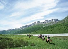 Trek Mongolia's 2,456-square-mile Altai Tavan Bogd National Park. We recommend Tusker Trail's 15-day, 100-mile Mongolia Trek—16 guests, six camels, a local guide, and a cook cover eight to ten jaw-dropping miles per day by foot and horseback.