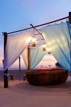 Romantic dining setting on the beach at Anantara Mui Ne Resort, Vietnam