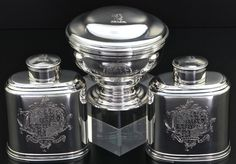 A very rare set of 2 silver tea caddies with matching sugar bowl  All pieces hallmarked for Samuel Taylor, London 1753  Height of caddies c. 10cm
