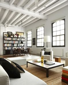 exposed beams, giant windows, wood floors....basically my dream urban living space