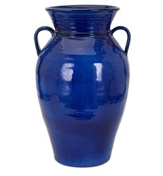 With Mediterranean flair, a large terra cotta pottery urn brings a fresh coastal style with a vivid solid cobalt blue glaze.