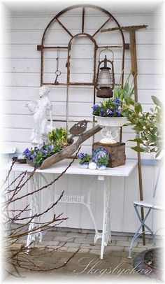 Porch decor-Love every beautiful layer, in this picture! Wood, metal, statuary; and plants equals Magic!!