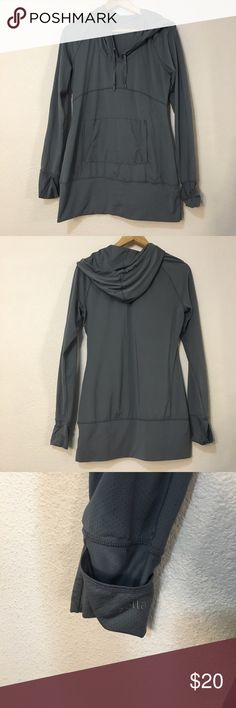 Zella nodded pullover size S Light gray Zella pull over. Has front pocket pouch to store keys and cards. Has arm covers that pull over fingertips. Could cinches closed with drawstring to tighten up and keep cold weather out! Overall pull over is in great used condition! Zella Tops Sweatshirts & Hoodies