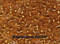 Artesanías y Abalorios Ónix: Mostacillos, mostacillón o chaquiras en color naranja ocre.