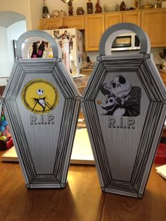 These were our popcorn boxes .  I bought the boxes at Oriental trade and added the Nightmare before Christmas decoration on them.  Decorations were downloaded images from computer printed on card stock and cut out, then pasted  on both sides of the boxes.