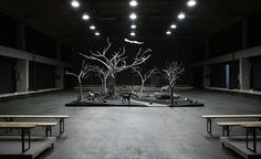 Men's A/W 2014 season / Thom Browne: The designer took his guests to a moody forest for his latest show, creating a monochromatic woodland scene clad in assorted men's tailoring fabrics in the centre of his grey catwalk. The woodland is a nod to the leaf embroidery motif used in the collection