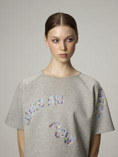 "Hazel Crew is wearing our embroidered neoprene sweat-shirt ""Wizz""."