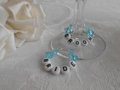 Bride and Groom wedding wine glass charms - can be persoanlised to wedding colour scheme and would look great on the top table.