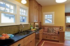green/sage backsplash and yellow wall with natural cabinets, probably not the black counter. Craftsman Style Exterior, Craftsman Homes, Craftsman Bungalows, Farmhouse Remodel, Kitchen Remodel, Natural Cabinets, Kitchen Ideas, Kitchen Design, Bungalow Kitchen