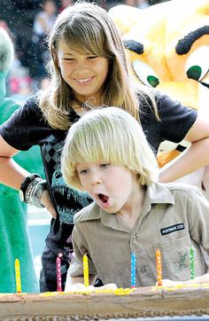 Birthday attracts party animals! Bindi Irwin watches little brother Robert blow out candles on his seventh birthday cake at Australia Zoo (2nd Dec 2010 2:00 AM).