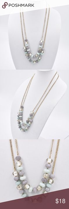 """Double Strand Beaded Necklace This is a double strand Beaded necklace from Ann Taylor Loft. The chain is gold-tone metal and is approximately 30"""" in length. It features faceted beads in muted tones of blue, gray and clear. ann taylor loft Jewelry Necklaces"""