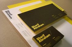 Sharif Abraham stationery offset printed in 2 spot colours on Knight white smooth 120gsm and Optix Suni Yellow 200gsm.  Business cards offset printed in 1 colour 2 sides then clear spot gloss foiled and triplexed together with Optix Jetz Black 200gsm inserted.  Designed by Soft Pyramids.