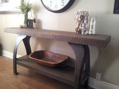 This console was created using a thick rough sawn top and shelf finished in a dark walnut stain. The base is an antique cast iron lathe base.