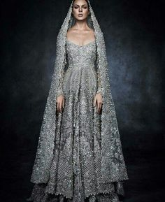 One stunning bridal inspiration from #SparklingCouture exhibition in Dubai coming your way! We're swooning over this exquisite dress by @elanofficial in collaboration with @swarovski. If you're looking for something extravagant, this can be your ultimate option! Truly love this dramatic bejeweled gown in gray hue that oozes a glamorous yet romantic vibe. Isn't this an amazing piece? Double tap if you agree! Image via @weddedwonderland