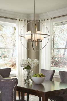 The silhouette of the modern Alturas lighting collection by Sea Gull Lighting features an interlocking, spherical steel frame, which harkens back to the Unisphere constructed for the 1964 New York World's Fair. The minimalist Alturas globe chandelier draws the eye to the soft, warm glow of the light emitted from the Satin Etched glass shades.