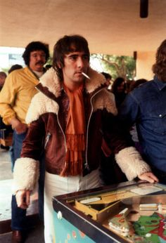 Keith Moon of The Who playing pinball in 1975