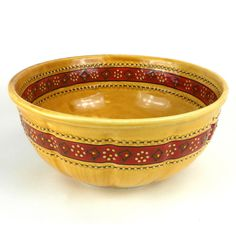 Large Bowl - Honey Handmade and Fair Trade. Eleven and a half inches in diameter, lead-free, dishwasher and microwave safe, this richly-colored bowl is handcrafted and painted by Mexican artisans. While a very functional piece, the inside and outside of this 4-inch tall bowl is covered with a textured pattern making each piece unique.