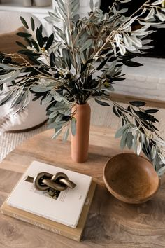 A few stems of fake olive branches are the perfect addition to any space this fall for your home decor refresh. Simply trim stems down to fit your favorite ceramic vase and voila! Shop artificial leaf branches and ceramic vases at Afloral.com.
