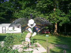 Satellite dish turned butterfly Under Deck Storage, Under Decks, Satellite Dish, Unique Gardens, Topiary, Gardening Tips, Repurposed, Garden Ideas, Recycling