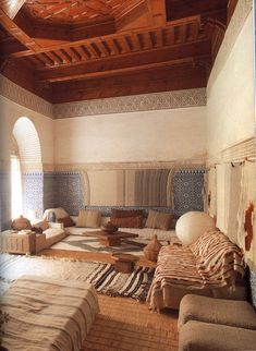 Moroccan Interiors by Lisa Lovatt-Smith Never really loved a living room design until now. The rugs and low seating.