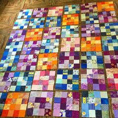 I have pulled out some very old scraps and trying to turn them into a useful quilt. This is blue, purple, orange, and pink 16-patch blocks. My plan is to sash them with bright white for a happy cheerful quilt. It feels good to use scraps