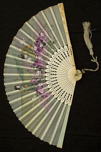 Hand-painted silk/ivory fan, circa 1910. Japanese figures set in a floral landscape.