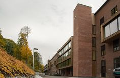 Various Architects has renovated a historical office building in Lodalen, Oslo, creating various wooden boxes that intrude into the original brick facade. Brick Facade, Contemporary Office, Architect Design, Oslo, Mother Earth, Norway, Multi Story Building, Industrial, Offices
