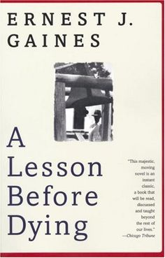 reads: a lesson before dying--earnest j. gaines. i read this during banned books week in high school. recommended.