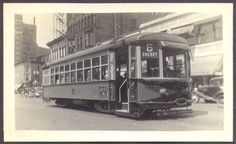 Street car traveling down Monroe Center; the building with the awnings on the right is now the Children's Museum - c. 1940