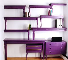 Definitely not a fan of the purple but I think if done right, this could be the perfect space saving solution for the library/office area.  :)  Gonna do this but in black or hmmm... maybe red.  I don't know, colored furniture makes me nervous!  lol  I need TWO wooden coffee tables and a desk like this  I'm gonna saw the tables in half to make the shelves.