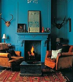 Intense deep teal walls and fireplace with earth brown and red furniture and acc.- Intense deep teal walls and fireplace with earth brown and red furniture and accessories and antiques plus antlers Teal Living Rooms, Blue Rooms, Beautiful Living Rooms, My Living Room, Living Spaces, Blue And Orange Living Room, Burnt Orange Bedroom, Dark Teal Bedroom, Burnt Orange Decor