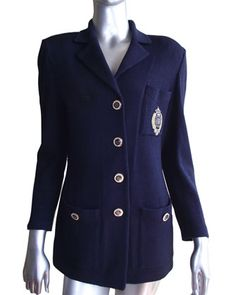 St. John Knit Blazer    Size: 2    Condition: Very Good - gently worn    Color: Navy Blue    Value: $1,200    Our Price:$400!      St. John Knits International Inc., commonly referred as St. John, is an upscale American fashion brand that specializes in women's knitwear. The company is best known...