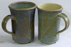 These two cone 6 oxidation mugs have the same Alberta Slip slip based glaze (with 20% frit 3134 and 4% rutile). However the mug on the left has 4% strontium carbonate added. It is amazing how it can be so blue and have no cobalt!