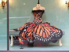 This is kind of neat... I don't know if I'd ever where it but I like the idea of a butterfly print on a dress!