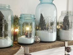 Ball jars filled with miniature Christmas scenes and epson salt to represent snow