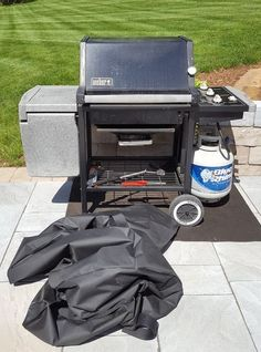two gas grills one vermont castings gas or propane and one weber propane grill both w newer cover accessories